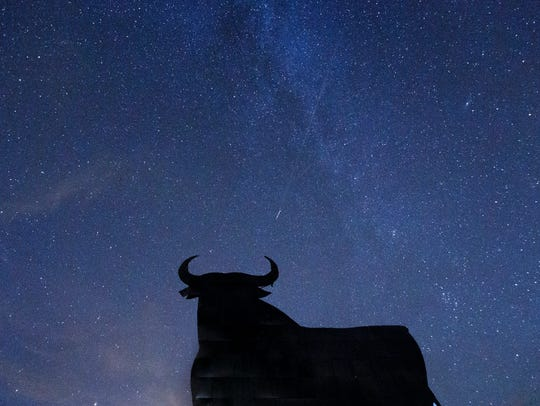 A Perseid meteor streaks across the sky during the