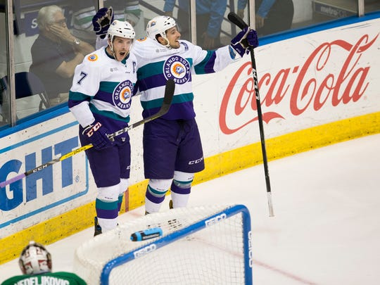 The Solar Bears' Eric Baier, left, and Denver Manderson celebrate after Baier scored during the second period of Game 2 of the Kelly Cup Playoffs, South Division semifinals at Germain Arena Friday, April 14, 2017 in Estero, Fla. Orlando led 2-1 at the end of the second period.
