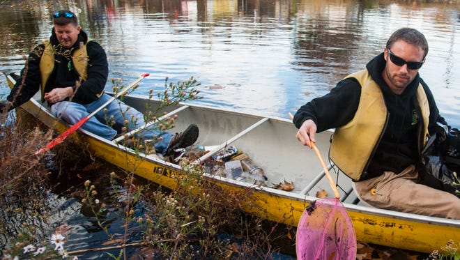 For the first time, volunteers with nets, grabbers and large plastic bags left the shoreline, climbing into canoes to catch trash that floated out of arm's way.