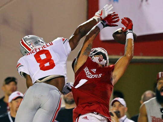 Ohio State cornerback Kendall Sheffield breaks up a pass intended for Indiana's Simmie Cobbs.