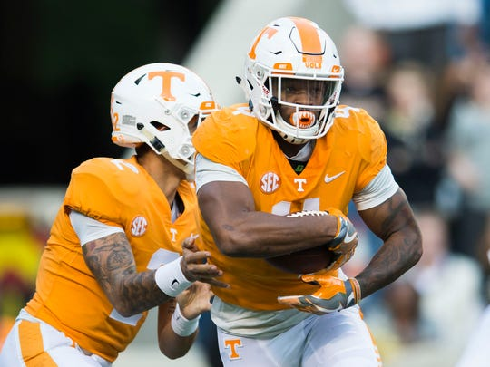 Tennessee running back John Kelly (4) runs with the ball during a game between Tennessee and Vanderbilt at Neyland Stadium in Knoxville, Tenn., on Saturday Nov. 25, 2017.