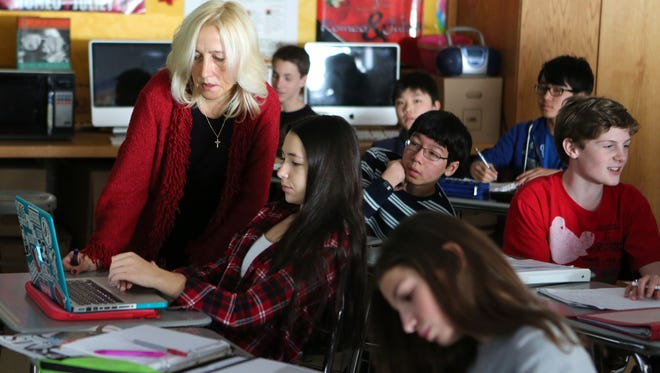 Kathleen Connon, an eighth-grade English teacher at Scarsdale Middle School, is pictured in her class on Friday. Connon won an award from the 9/11 Tribute Center for her curriculum on the 9/11 attacks.