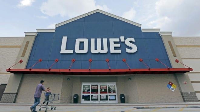 FILE - In this June 29, 2016, file photo, customers walk toward a Lowe's store in Hialeah, Fla.