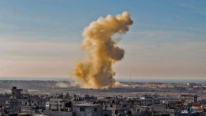 A picture taken on Nov. 28, 2017 from Rafah in the southern Gaza Strip shows smoke billowing following an explosion close to the border on the Egyptian side of the divided city.