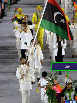 Mohamed Fuad Hrezi carries the flag of Libya during the opening ceremony for the 2016 Summer Olympics in Rio de Janeiro, Brazil, Friday, Aug. 5, 2016.