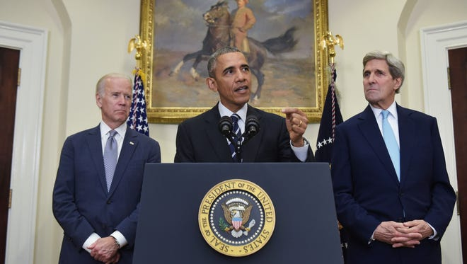 President Obama speaks on the Keystone XL pipeline, flanked by Secretary of State John Kerry and Vice President Joe Biden, Friday in the Roosevelt Room of the White House.