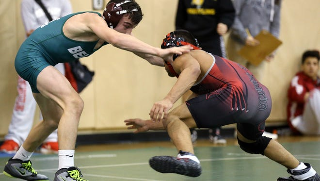 Mitch Polito of East Brunswick wrestles Joseph Pacheco of Perth Amboy in the 106lb final, Tuesday, December 29, 2015, at the Bear Invitational wrestling tournament in East Brunswick.