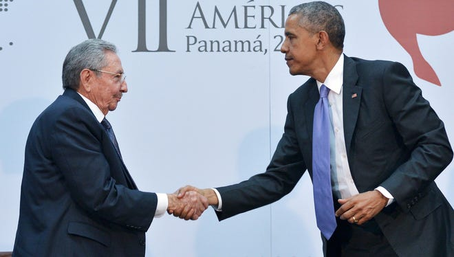 President Obama greets Cuban President Raul Castro on the sidelines of the Summit of the Americas on April 11, 2015, in Panama City.