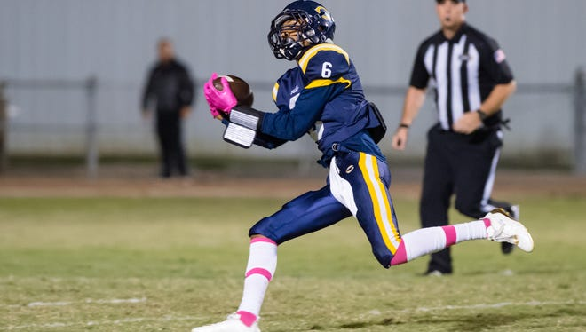 Deion Senegal makes a catch as the Carencro Bears take on St Thomas More Cougars. Thursday, Oct. 26, 2017.