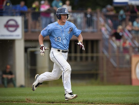 The St. Cloud Rox's Austin Athmann runs to first base