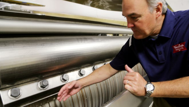 Clay Galarneau, COO of Verndale, gives a tour of the roller-dried whole milk supplier's brand new 82,000-square-foot plant on Weaver Street in west Detroit, near the Southfield Freeway, Wednesday, Sept. 17, 2014.