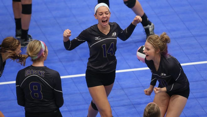 Johnston players, shown after a point at the 2013 state volleyball tournament, are rising in the state's rankings.