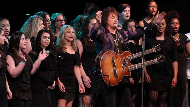 Richie Sambora performs with the Manchester High School Chorus at the Pine Belt Arena in Toms River on Tuesday night during a drug forum sponsored by the Ocean County Prosecutor?s Office.  Thomas P. Costello/Staff Photographer Musician Richie Sambora performs with Manchester Township students at the Pine Belt Arena in Toms River, NJ, Tuesday night, May 27, 2014, during a drup forum sponsored by the Ocean County Prosecutors office.