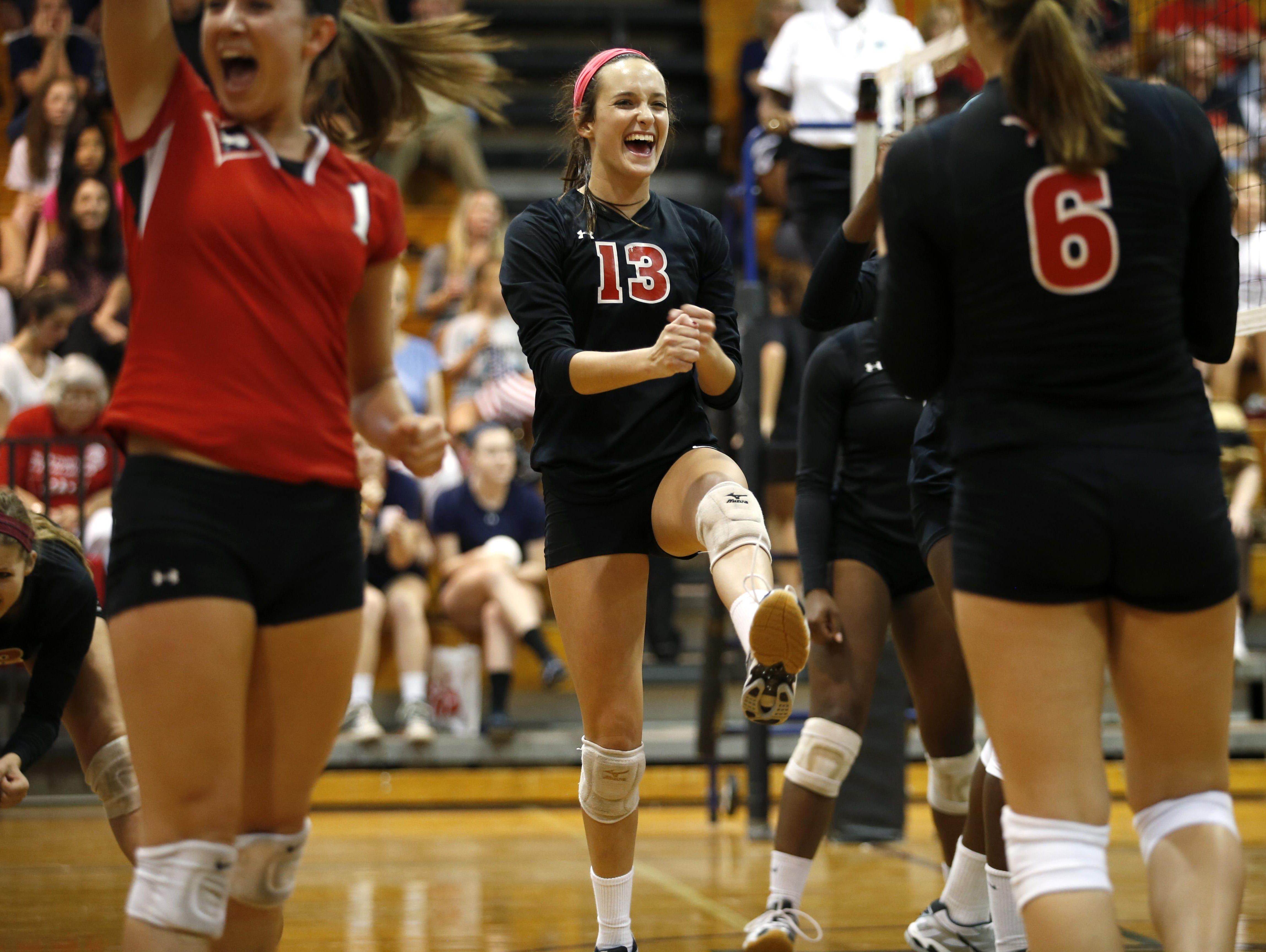 Leon senior setter Jaynie Mitchell, center, posted 115 assists, 30 digs and five aces as the Lions went 3-2 at Berkeley Prep's tournament in Tampa.