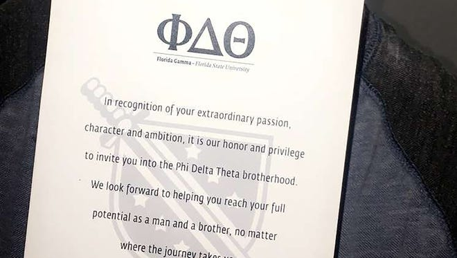 Arik Ancelin, a 15-year-old with Down syndrome, shows the bid card he received Oct. 14, 2017, to become an honorary member of Phi Delta Theta fraternity at Florida State University in Tallahassee.