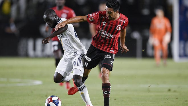 With 111 Major League Soccer matches to his credit, former LA Galaxy midfielder Emmanuel Boateng (24), here battling Washington Camacho of Club Tijuana in a 2019 game, gives the Crew depth and experience.