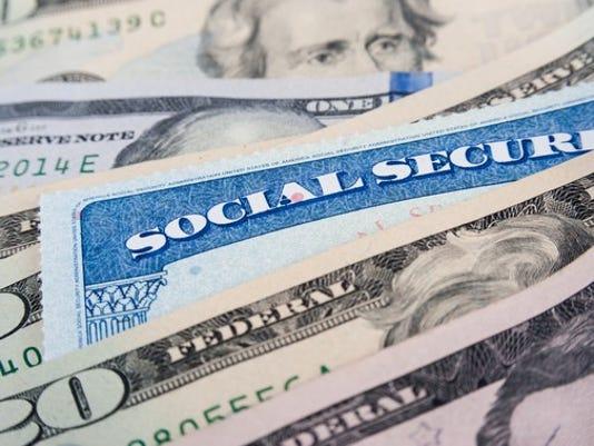 social-security-card-on-money_large.jpg