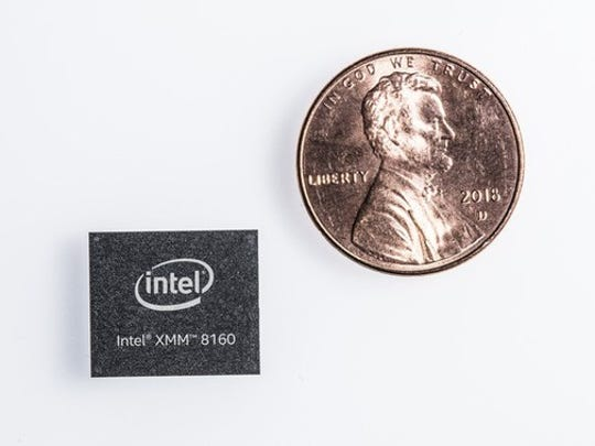 An Intel 5G modem next to a penny.