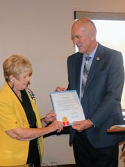 Mayor Richard Boss hands the Constitution Week proclamation