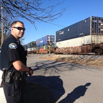 A Greenbrier Police Officer watches a train pass through one of the city's six crossings. The Tennessee Department of Transportation will soon be adding safety upgrades to two of those six crossings.