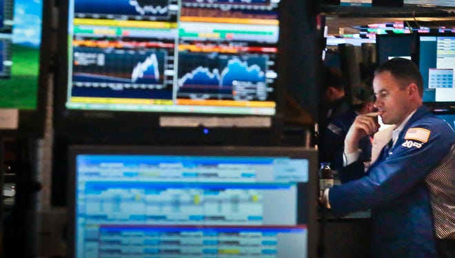 A trader works at his post on the floor of the New York Stock Exchange.