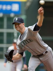 Seattle Mariners starting pitcher J.A. Happ throws against the Houston Astros in the first inning of a baseball game on Sunday, May 3, 2015, in Houston, Texas.