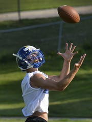 St. Cloud Cathedral's Brady Buckentine catches a pass