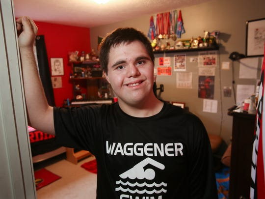 Jake Manning, 16, stands outside his bedroom at his