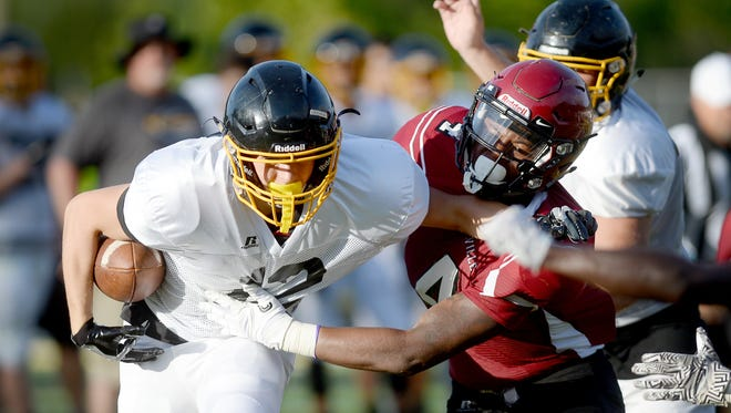 Asheville High's DeAndre Gaskin, left, has committed to play college football for Mars Hill.
