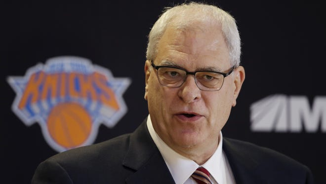 Phil Jackson is introduced as the new president of the New York Knicks, Tuesday, March 18, 2014 in New York. Jackson, who won two NBA titles as a player for the New York Knicks, also won 11 championships while coaching the Chicago Bulls and the Los Angeles Lakers. (AP Photo/Mark Lennihan)