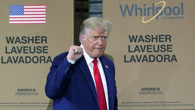 President Donald Trump pumps his fist as he leaves a rally at the Whirlpool Manufacturing Plant on Thursday, Aug. 6, in Clyde.