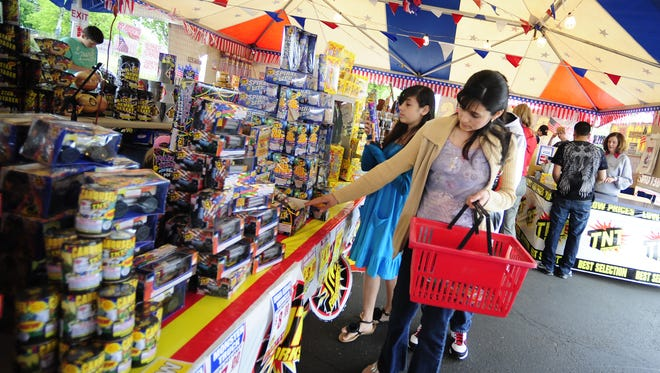 Shoppers browse fireworks at a stand in the Winco parking lot in 2011.