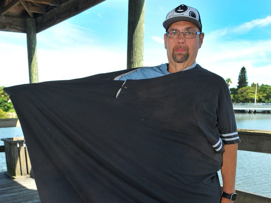 Fred Riley shows a 10XL night shirt he wore when he weighed over 700 pounds.