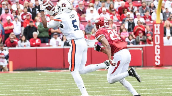 Ricardo Louis (5) attempts to catch a pass against Arkansas in a game on October 24, 2015 in Fayetteville, Ark.