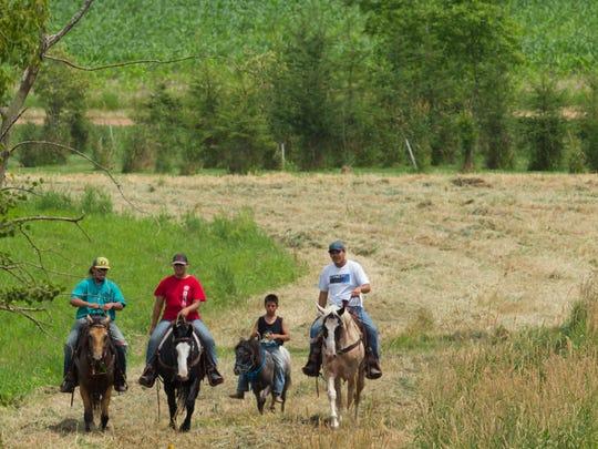A group rides along the oil pipeline easement for Enbridge