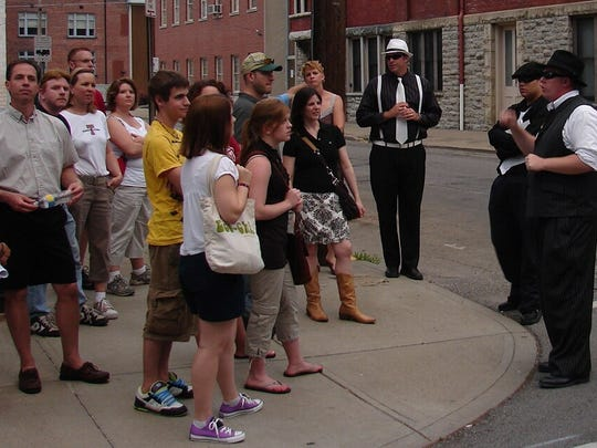 """Gangsters, Gamblers & Girls tour guides talk to a crowd about Newport's """"Sin City"""" past."""