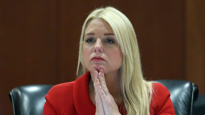 Florida Attorney General Pam Bondi listens to a report of the investigation of Dozier reform school during a cabinet meeting at the state Capitol, Thursday, Jan. 21, 2016, in Tallahassee, Fla.
