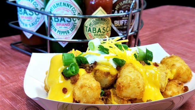 You'll find a fun selection of Tabasco sauces to enliven your meal--such as these loaded Tater Tots, at Tucker's Comfort Food.
