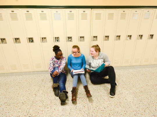 Ninth-graders Takemah Adams, Elizabeth Arvey and Ashleigh Anes study together in a hallway at Ashwaubenon High School. In 2014-15, the district drew 1,002 students from others districts, while 1,800 left the Green Bay district.
