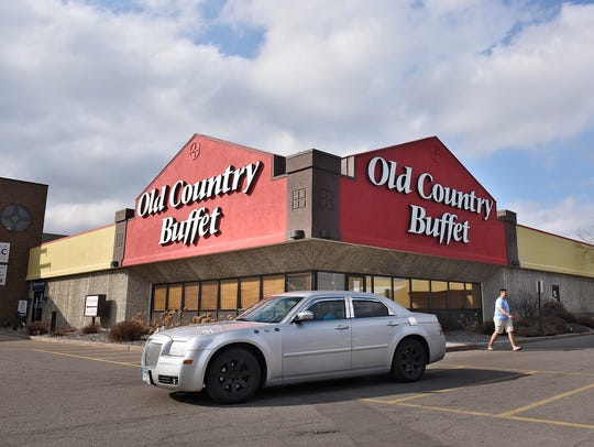 Traffic moves past the St. Cloud Old Country Buffet