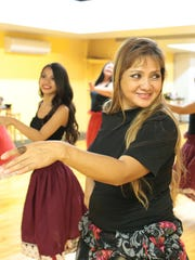 "Dorothy ""Dottie"" Marques, center, demonstrates dance techniques during a hula dance class held at the GYM Guahan in Maite on Aug. 11."