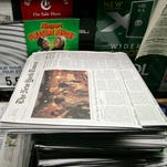 Copies of The New York Times are sold in New York.