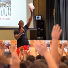 Cardinals Pro Bowl cornerback Patrick Peterson practices the technique that Chandler San Marcos Elementary School teachers use to quiet their students.