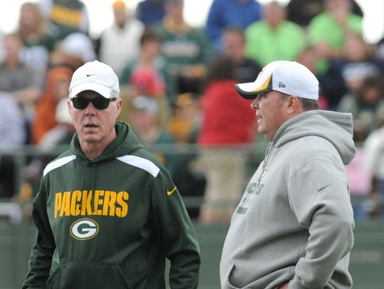 Green Bay Packers general manager Ted Thompson, left,