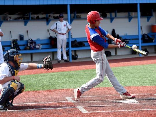 Hebron Post 285 Junior's Noah Kirkpatrick (right) bats