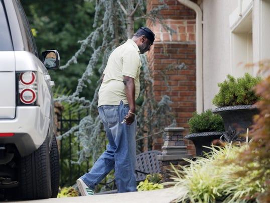 Bobbi Kristina Brown's uncle Gary Houston arrives Monday at the home in Alpharetta, Ga.