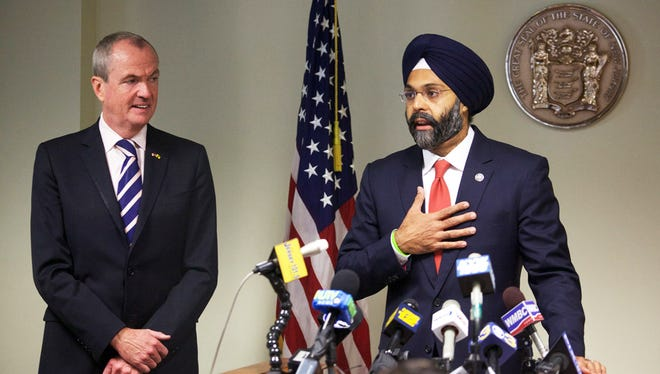 Gov.-Elect Phil Murphy introduced his choice for attorney general, Bergen County Prosecutor Gurbir S. Grewal, in Trenton on Tuesday afternoon.