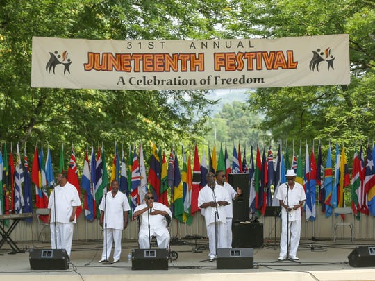 Prodigal Sunz sing gospel music at the 31st annual Juneteenth Festival on Sunday, June 17, 2018, at Eden Park in Cincinnati. The Juneteenth Festival is a celebration of the end of slavery.