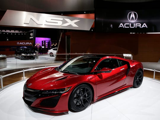 The 2016 Acura NSX is seen on display at a media event at the 2015 New York International Auto Show at the Jacob K. Javits Center in New York City, New York, April 2, 2015.
