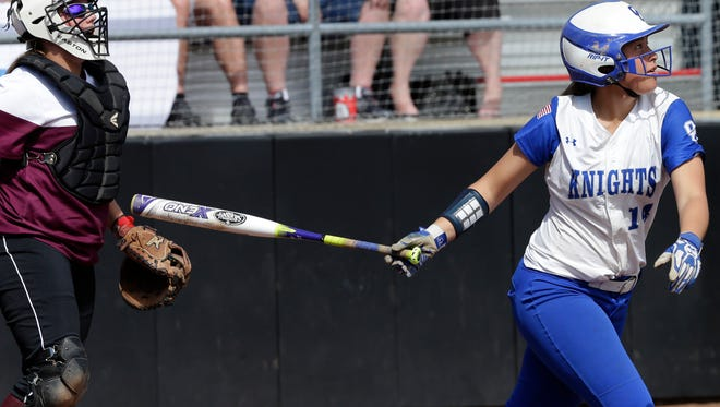 Oak Creek's Peyton Strong hits a two-run double in the Knights' 6-1 victory over Menomonee Falls in the WIAA Division 1 state quarterfinals Thursday in Madison.